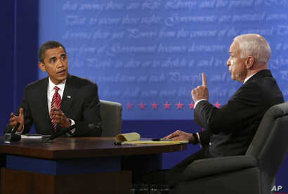 FILE - Democratic presidential candidate Sen. Barack Obama, D-Ill., and Republican presidential candidate Sen. John McCain, R-Ariz., talk during the presidential debate Wednesday, Oct. 15, 2008, at Hofstra University in Hempstead, N.Y.