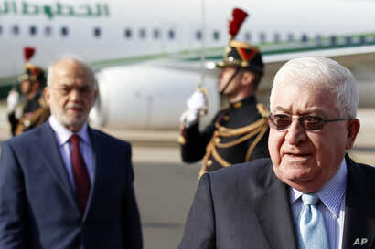 Iraq President Fouad Massoum, right, followed by Iraq Foreign Minister Ibrahim Al-Jaafari, left, arrive with Iraqi officials at Orly airport south of Paris, France, Sunday, Sept. 14, 2014 ahead of a conference with U.S. Secretary of State John Kerry,...