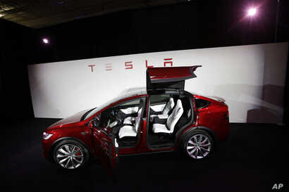The Tesla Model X car is introduced at the company's headquarters in Fremont, California, Sept. 29, 2015.