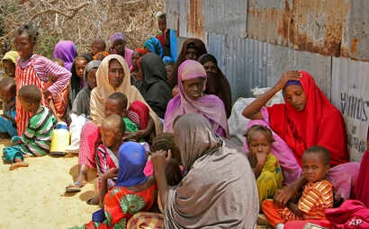 Displaced Somalis who fled the drought in southern Somalia sit in a camp in the capital Mogadishu, Somalia, Feb. 18, 2017.