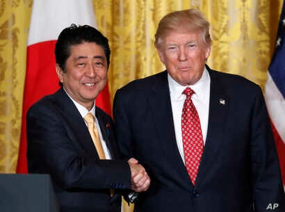 President Donald Trump, right, and Japanese Prime Minister Shinzo Abe shake hands following their joint news conference in the East Room of the White House in Washington, Feb. 10, 2017.