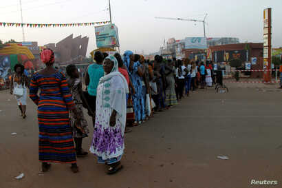 People stand in line during the Panafrican Film and Television Festival (FESPACO) in Ouagadougou, Burkina Faso, March 3, 2017.