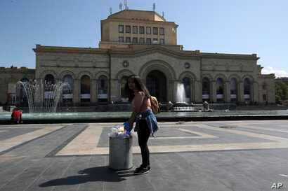 Volunteers clean the Republic square in Yerevan, May 3, 2018, after the daily protests by opposition lawmaker Nikol Pashinian and their supporters.