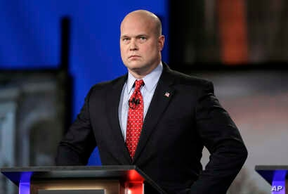 FILE - Then-Iowa Republican senatorial candidate and former U.S. Attorney Matt Whitaker is pictured before a televised debate in Johnston, Iowa, April 24, 2014. President Donald Trump announced Nov. 7, 2018, that he was naming Whitaker acting U.S. at