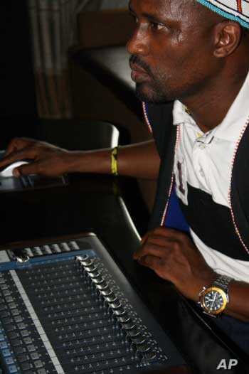 Madlingozi concentrates as he tries to perfect a mix on a new song in his studio in Johannesburg