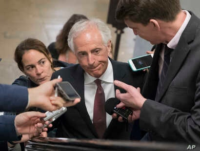 FILE - Senate Foreign Relations Committee Chairman Sen. Bob Corker, R-Tenn. is surrounded by reporters on Capitol Hill in Washington, May 16, 2017.