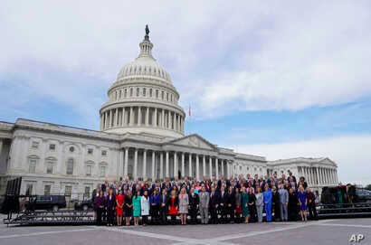 Members of the freshman class of Congress pose for a photo on Capitol Hill in Washington, Nov. 14, 2018, in Washington.