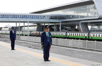 FILE - Kenya Railways attendants prepare to receive a train launched to operate on Standard Gauge Railway line constructed by the China Road and Bridge Corporation (CRBC) and financed by Chinese government as it arrives at the Nairobi Terminus, Nairo...