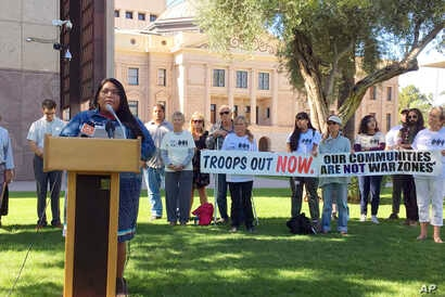 Amy Juan, a citizen of the Tohono O'odham Nation in Arizona, speaks out against the military's presence at the U.S.-Mexico border in Phoenix Thursday, Nov. 8, 2018.