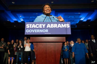 FILE - Georgia Democratic gubernatorial candidate Stacey Abrams speaks to supporters about her expectations of a run-off during an election night watch party, Nov. 6, 2018, in Atlanta.