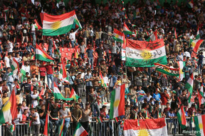 People celebrate to show their support for the upcoming September 25th independence referendum in Zakho, Iraq, Sept. 14, 2017.
