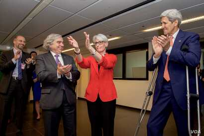 U.S. Secretary of State John Kerry and U.S. Energy Secretary Dr. Ernest Moniz applaud State Department Under Secretary for Political Affairs Wendy Sherman as she, in turn, thanks members of the United States negotiating team in Vienna, Austria, July ...