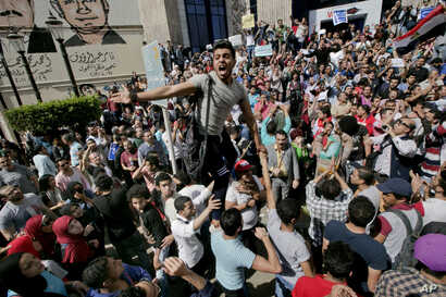 FILE - Egyptians shout slogans against Egyptian President Abdel-Fattah el-Sissi during a protest against the decision to hand over control of two strategic Red Sea islands to Saudi Arabia, in Cairo, Egypt, April 15, 2016.