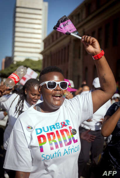 FILE - A woman chants slogans as members of the South African Lesbian, Gay, Bisexual and Transgender and Intersex (LGBTI) community take part in the annual Gay Pride Parade, as part of the three-day Durban Pride Festival, on June 24, 2017 in Durban.