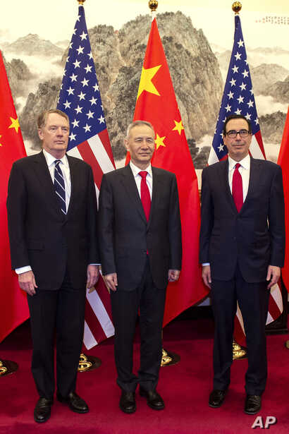 China's Vice Premier Liu He, center, poses for a photo with U.S. Treasury Secretary Steven Mnuchin, right, and U.S. Trade Representative Robert Lighthizer at Diaoyutai State Guesthouse in Beijing, March 29, 2019.