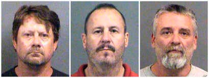 FILE - This combination of Oct. 14, 2016, file booking photos  shows from left, Patrick Stein, Curtis Allen and Gavin Wright, three members of a Kansas militia group who were charged with plotting to bomb an apartment building filled with Somali immi...
