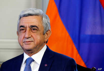 FILE PHOTO -  Serzh Sargsyan poses at the opening of talks with Azerbaijan in Geneva, Switzerland October 16, 2017.