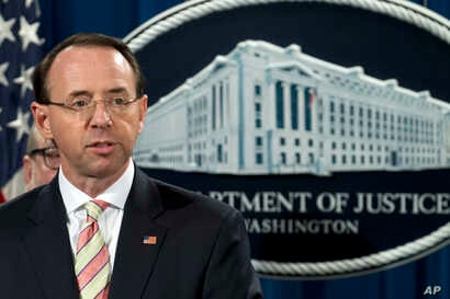 FILE - Deputy Attorney General Rod Rosenstein speaks during a news conference in which he announced an indictment against Iranian hackers in an alleged cybercrime and extortion scheme, at the Department of Justice in Washington, Nov. 28, 2018.