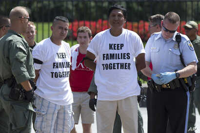 Demonstrators are arrested outside the White House in Washington, Aug. 28, 2014, during a protest for immigration reform. Trump's plans could lead to the deportation of more than six million illegal imigrants.