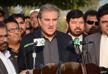 FILE - Pakistani Foreign Minister Shah Mehmood Qureshi talks with media representatives in Multan, Pakistan, Dec. 22, 2018.
