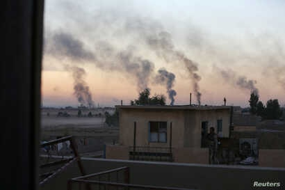 Smoke rises from clashes during a battle with Islamic State militants in southeast of Mosul, Iraq, Nov. 3, 2016