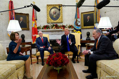 U.S. President Donald Trump speaks next to Vice President Mike Pence (2ndL) while meeting with Senate Democratic Leader Chuck Schumer (D-NY) and House Democratic Leader Nancy Pelosi (D-CA) at the White House in Washington, Dec. 11, 2018.