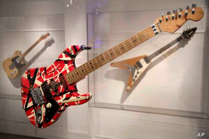 "A guitar made and played by Eddie Van Halen of Van Halen is displayed at the exhibit ""Play It Loud: Instruments of Rock & Roll"" at the Metropolitan Museum of Art in New York, April 1, 2019."