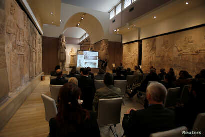 Participants in the Antiquities Protection Workshop attend a lecture in an effort counter heritage crimes and trafficking of artifacts at the Iraqi National Museum in Baghdad, Iraq, Jan. 23, 2019.