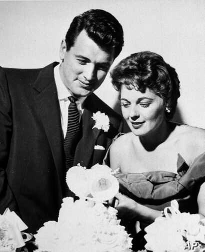 Film actor Rock Hudson, and Phyllis Gates, secretary to the actor's business agent, are  pictured with a wedding cake after their marriage at Santa Barbara, Calif., Nov. 9, 1955. It was the first marriage for both. Hudson is 29 and the bride 25. They...