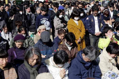 People mourn the victims of the March 11, 2011, earthquake and tsunami during a special memorial event in Tokyo,  March 11, 2017.