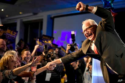 Minnesota Governor-elect Tim Walz celebrates during the election night event by the Democratic Party, Nov. 6, 2018, in St. Paul, Minn.