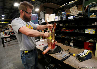 FILE - Joel Dykema works on the sub-assembly of a transformer in the RoMan Manufacturing plant in Grand Rapids, Mich., Dec. 12, 2018. A Federal Reserve report released Jan. 18, 2019, showedU.S. manufacturing output had surged by the most in 10 mont...