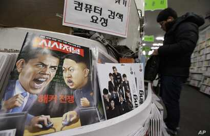 FILE - A magazine with caricatures of then-U.S. President Barack Obama and North Korean leader Kim Jong Un is displayed at a book store in Seoul, South Korea, Jan. 3, 2015. The United States imposed new sanctions at the time on North Korean governmen...