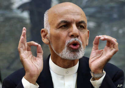 Afghanistan's President Ashraf Ghani talks during a press conference at presidential palace in Kabul, Afghanistan, Oct. 1, 2015.