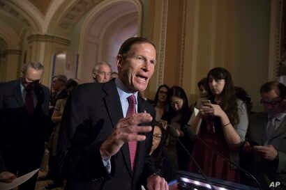 FILE - Sen. Richard Blumenthal, D-Conn., and other Democrats respond to questions from reporters about President Donald Trump reportedly sharing classified information with two Russian diplomats during a meeting in the Oval Office on Capitol Hill in