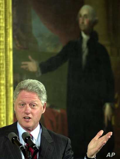 President Bill Clinton (42nd president)  delivers  remarks in the East Room of the White House with a portrait of George Washington (first president) behind him, Feb. 14, 2000.