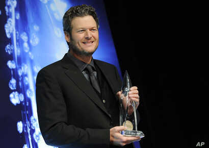 Blake Shelton poses in the press room with the award for Male Vocalist of the Year at the 48th annual CMA Awards, Nov. 5, 2014, in Nashville, Tennessee.