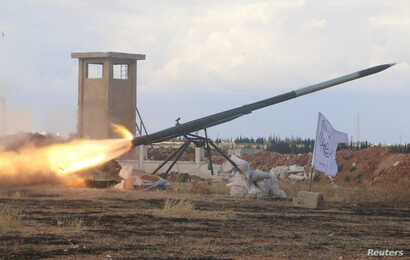 Rebel fighters from the First Regiment, part of the Free Syrian Army, fire a Grad rocket from Aleppo's al-Haidariya neighborhood, towards forces loyal to Syria's President Bashar al-Assad stationed in Talet al-Sheikh Youssef, Syria, May 29, 2016.
