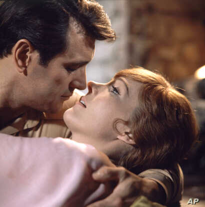 """Actress Julie Andrews shown along and together with actor Rock Hudson, both are working together in her movie ?Darling Lili, or where were you the night you said you shot down Baron Von Richtofen""""  on May 7, 1968."""