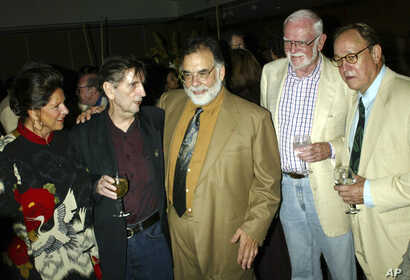 """FILE - In this July 18, 2003, file photo, from left, Lainie Kazan, Harry Dean Stanton, Francis Ford Coppola, Frank Pierson and Frederic Forrest reunite during a reception for the screening of the 1982 movie """"One from the Heart,"""" at the Academy of Mot..."""