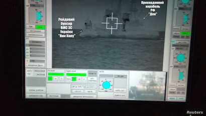 A screen shows a Russian border guard vessel Don trying to stop a Ukrainian Navy tug boat as three Ukrainian ships make a journey from the Black Sea port of Odessa via the Kerch Strait to Mariupol on the Sea of Azov, in the Black Sea, Nov.  25, 2018....