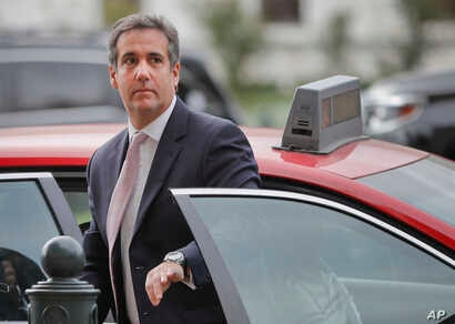Michael Cohen, President Donald Trump's personal attorney, steps out of a cab during his arrival on Capitol Hill in Washington, Sept. 19, 2017.