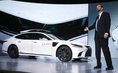 Gill Pratt, CEO of the Toyota Research Institute, unveils Toyota's latest autonomous-driving test vehicle for the Toyota Research Institute, called P4, based on the new-generation Lexus LS500h hybrid luxury sedan, with a roof-mounted assembly with ca...