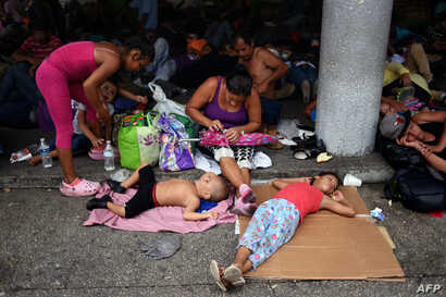 Honduran migrants taking part in a caravan heading to the US, rest in Tapachula, Chiapas state, Mexico, Oct. 21, 2018.