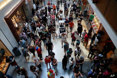 FILE - Protesters march through West County Mall in Des Peres, Missouri, Sept. 16, 2017.