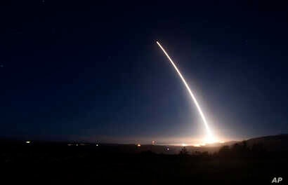 FILE photo provided by US Air Force -  an unarmed Minuteman III intercontinental ballistic missile launches during an operational test at Vandenberg Air Force Base, Calif.
