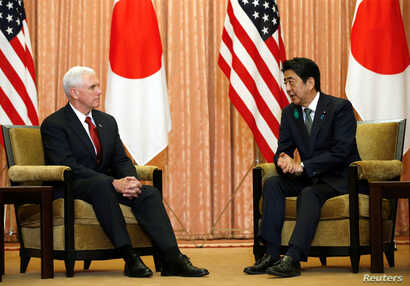 U.S. Vice President Mike Pence (L) talks with Japan's Prime Minister Shinzo Abe at Abe's official residence in Tokyo, April 18, 2017.