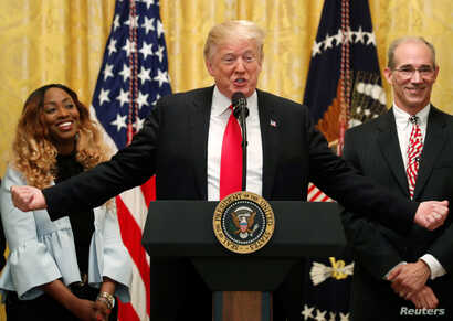U.S. President Donald Trump holds a news conference to mark six months since the passage of the Tax Cuts and Jobs Act, in the White House East Room in Washington, June 29, 2018.