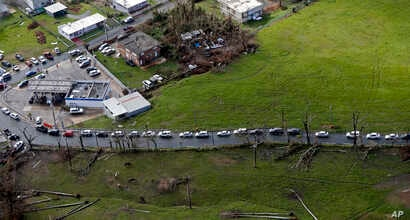 Cars are lined up to buy gas in the aftermath of Hurricane Maria in Toa Alta, Puerto Rico, Sept. 28, 2017.