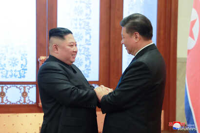 FILE - North Korean leader Kim Jong Un meets President Xi Jinping in Beijing, China, in this photo released by North Korea's Korean Central News Agency, Jan. 10, 2019.